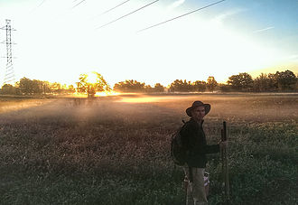 Archaeologist Matty Gibson in field at sunset